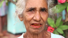 Portrait of an elderly woman with teeth eaten by paan. Stock Footage