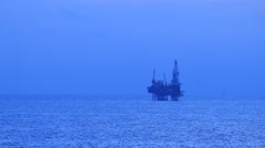 Jack up drilling rig in the middle of the ocean Stock Footage