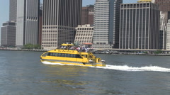 Wide New York yellow river taxi Manhattan Stock Footage