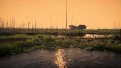 Boat ride through a floating farm in Inle Lake, Myanmar, at sunset - stock footage