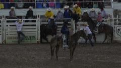 Rodeo bareback bronco cowboy delayed start slow 4K 263 Stock Footage