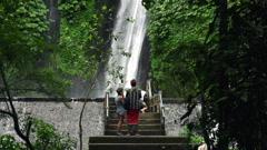 People admire beautiful waterfall in Bali, super slow motion, 240fps HD - stock footage