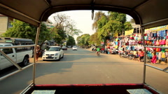 Streets of Mandalay seen from a taxi pick-up truck Stock Footage