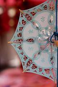 souvenir lace umbrella - stock photo