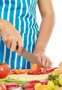 Stock Photo of beautiful woman cutting vegetables