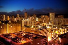 City View Of Waikiki, Oahu, Hawaii At Night Stock Photos