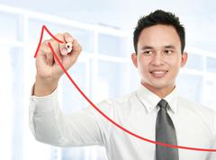 Young businessman drawing statistic Stock Photos