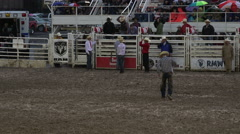 Rodeo cowboy walks back to chutes 4K 269 Stock Footage