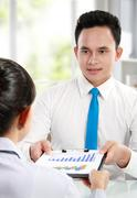 Stock Photo of man making a presentation and discussing bar chart