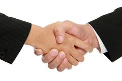 Hand shake between a businessman and a businesswoman Stock Photos