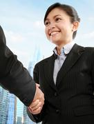 Stock Photo of business woman shaking hands