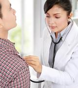 Doctor taking the heartbeat Stock Photos