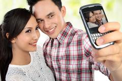 Stock Photo of young couple taking self portrait