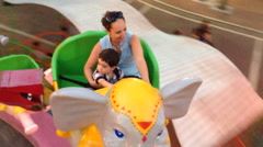 Mother and child in an amusement park Stock Footage