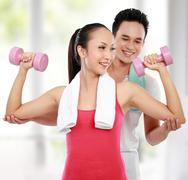 fitness smiling young man and woman - stock photo