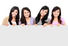 girls holding white board - stock photo