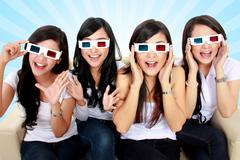 Surprised young woman in 3d glasses Stock Photos