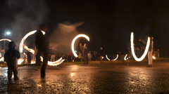 People presenting a fire show. time-lapse - stock footage