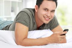 Stock Photo of man texting message