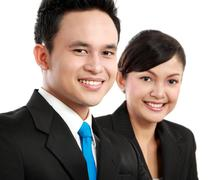Man and woman office worker smiling Stock Photos