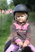Little girl on pony Stock Photos