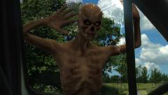 walking dead undead zombie strikes against car disc - stock footage