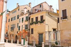 House on a narrow street in the italian city of venice, italy Stock Photos