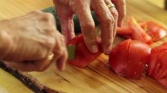 Woman cutting tomatos Stock Footage