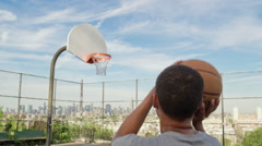 Teenager Scores Shot in Basketball Slow Motion Manhattan Skyline, NYC - stock footage