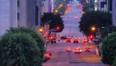 Perspective view of Flower Street traffic at dusk in downtown Los Angeles - stock footage