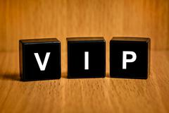 Vip or very important person word on black block Stock Photos