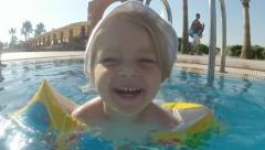 Happy Funny Little Girl First Time Go to Swim the Summer Sunny Pool - stock footage