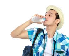 Stock Photo of traveler drinking water