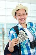 Stock Photo of traveler with some money