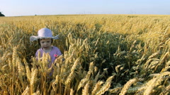 Cute small girl  walking in a agriculture field 2 sequences Stock Footage