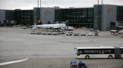 Stock Video Footage of Airport, Frankfurt, Passenger and luggage terminal vehicles