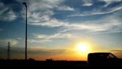 Car passing by in sunset Stock Footage