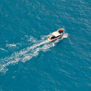 Stock Photo of Motor boat driving fast on the blue sea