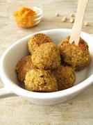 Falafel balls with carrots dip - stock photo