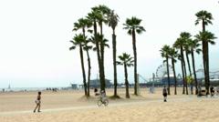 4K, UHD, Roller-skating and bicycles riding in Santa Monica, BlackMagic Camera Stock Footage