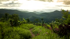 HD time lapse Wide Mountain view sun beam zoom in Stock Footage