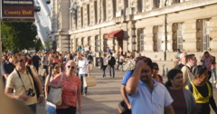 Crowds in the London sun zoom 4K - stock footage