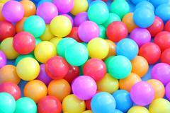 Plastic multiple color balls children play field. Stock Photos