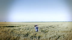 Farmer with daughter in agriculture field enjoy on view Stock Footage