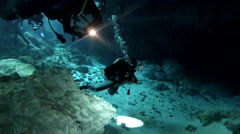 Divers Entering Cave Stock Footage