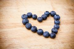 Fresh blueberries in the shape of heart Stock Photos
