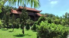Vietnam Phú Mỹ district villages 022 exotic plants around temple portal Stock Footage