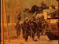 Iraq War - Marine unit running to meet up with convoy and relocate position - stock footage