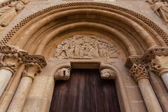 archivolts in the romanesque style door of san isidoro collegiate in leon - stock photo