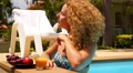 Attractive Woman Enjoying Juice and Sunbathing in Swimming Pool in Resort. Footage